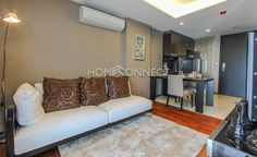 1 Bedroom Condo for Rent at The Address 61  -  Learn more of this rental & other available apartments or condos for rent, go to http://www.homeconnectthailand.com/bangkok-condos-for-rent/  This posh 1-bedroom condo for rent at The Address 61 is ideal for a single yuppie or couple. Ready to move in today, this luxurious 47-square meter low rise dwelling has a swanky main area fitted with an ivory sofa, rug, stand lamp, tv/console, wall print, and select decorative pieces. A