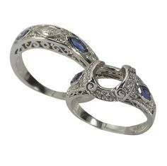 Antique Diamond Sapphire Two Ring Engagement Setting -  This two ring engagement set will hold a 1.00ct round or oval center diamond.    These are set with marquise shape diamonds and sapphire accents. Antique style wedding bands are popular and in demand. The engagement rings have filigree, open scrollwork and delicate lines. These rings are made with a heavy gold weight which insures years of carefree wear.    The characteristics of such rings are milgrain, engraving and scrollwork. Our...