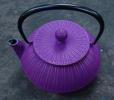 Japanese Tetsubin Cast Iron Teapot - Kikka -Modern, striking, and a perfect size. Based on a chrysanthemum flower, raised lines decorate the body of this teapot with hints of gold peeking through.