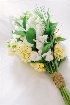Simple white and yellow bridal bouquet. Floral Design: Ashley Elaine ---> http://www.weddingchicks.com/2014/05/12/are-you-a-camera-shy-bride-or-groom/
