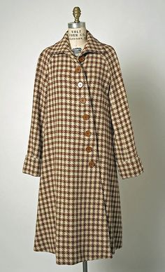 Coat. House of Balenciaga (French, founded 1937). Designer: Cristobal Balenciaga (Spanish, 1895–1972). Date: spring/summer 1950. Culture: French. Medium: wool. Dimensions: Length at CB: 46 3/4 in. (118.7 cm).