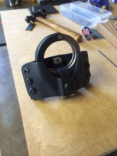 Kydex holder for ASP handcuffs.