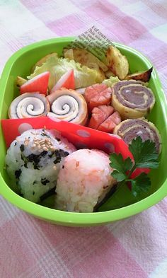 Just a very pretty bento with two rolled things: one is meat based and the other is fish paste (chikuwa) based.