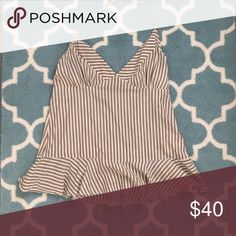 REDUCED! Ben Sherman halter tank Ben Sherman halter tank.cute tank, great for casual-wear. But unfortunately I have a bit of a cleavage issue (in which I have none). So I'm selling. Ben Sherman Tops