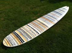 Tribal design surfboard art by Becky Hutchens, using Posca pens.