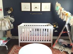 Eclectic Navy and Coral Girl's Nursery - love the navy accent wall!