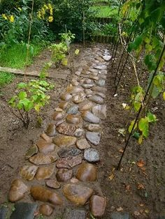 Work a bag of dry concrete mix into the soil where stone is to sit, lay stone, water it all in so it sets just like Jello only harder! This would work perfect for garden paths. Lawn And Garden, Garden Paths, Garden Art, Garden Landscaping, Home And Garden, Garden Junk, Garden Tips, Outdoor Projects, Garden Projects
