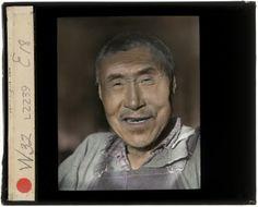 Hand-colored lantern slide; indoor portrait of Qaurtuculi (James Anaver's father) of Kipnuk posing in overalls.Yup'ik,1935-1936. Kipnuk, Alaska. Collodion positive transparency (glass)