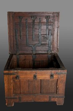 Late medieval oak chest with iron straps and 3 locks, 2 still working. The massive framing members nearly 3″ thick, this very heavy chest was probably intended for a guildhall or a church.