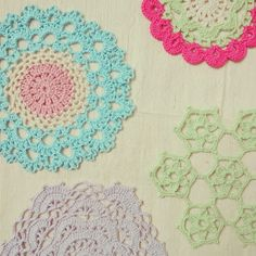 Crochet doilies in pretty pastel colors.