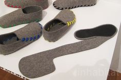 """Made from a single piece of biodegradable wool felt, """"Lasso"""" by Gaspard Tiné-Berés are warm, comfortable slippers that are stitched together with standard colored laces.    Read more: The Royal College of Art Unveil Weird and Wonderful Design For The Real World Exhibition During London Design Festival 
