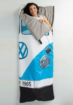Groovy Getaway Sleeping Bag: Roll up in this retro-inspired sleeping bag with a classic VW Van design featuring an oversized logo, headlights and a Euro inspired license plate.
