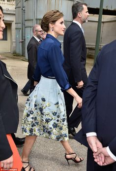 The stylish monarch wore a blue midi skirt embellished with intricate flowers ...