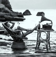 z- Daria Werbowy- Sitting on Chair in Ocean w Glass of Wine, Listening to Music