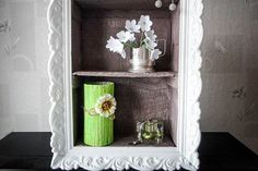 This DIY home decor idea is made of sturdy cardboard and combinates the functionality of a wall shelf and the beauty of an ornamented painting frame. Cheap