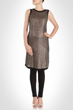 Kavita Bhartia - This stylish tunic is the perfect garment to wear to a cocktail party when paired with black leggings. The entire front bodice features gold sequins in scallop shapes which when styled with gold pumps would look gorgeous. SHOP NOW: www.kimaya.in