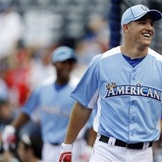 American League's Mike Trout, of the Los Angeles Angels, laughs during warmups for the MLB All-Star baseball game, Tuesday, July 10, 2012, in Kansas City, Mo. (AP Photo/Jeff Roberson)