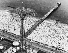 As the 2014 summer season kicks off this Memorial Day weekend, LIFE.com is taking a closer look at this iconic photo of Coney Island from 1952.