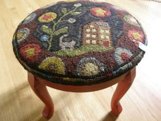 Footstool made from Starbud Blossom pattern from Payton Primitives. Hooked & photographed by Michele Nelson