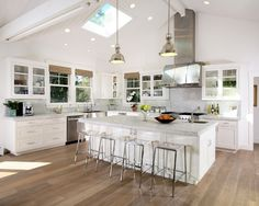 Sloped Ceiling spots, pendants over island