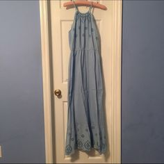 Light blue halter maxi dress. Light blue halter maxi dress. Eyelet detailing to top and bottom of dress. Elastic cinch waist. Single button closure. Wore twice. Fits like a medium in the bust. Single button back closure. Old Navy Dresses Maxi