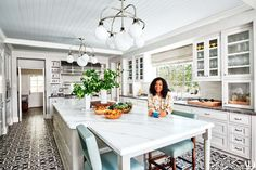 Shonda Rhimes, wearing a Chanel sweater, in the kitchen of her Los Angeles home. Ralph Lauren for Visual comfort chandeliers; on floors, custom tile by Native Tile & Ceramics. Fashion styling by Dana Asher Levine. Home Design Decor, House Design, Home Decor, Interior Design, Interior Ideas, Architectural Digest, Kitchen Design, Kitchen Decor, Kitchen Ideas