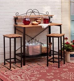 Powder-Coated Steel Outdoor Sideboard and Two Stools with Kempas Wood Surfaces . $199.95. There's no end to the uses you'll find for our versatile Outdoor Sideboard. Great next to your grill for extra cook space, or on your patio as a sideboard for outdoor entertaining. You can even use it as a potting bench or worktable with the matching stools.The durable Kempas woodwork surface stands up to the elements year after year, and will weather to a silver gray over time. Powd...