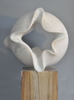 Marble sculpture with wooden base Carved Abstract Contemporary Modern sculpture statue carving sculpture by artist Nando Alvarez titled: 'Cloud (Nube) (Carved marble abstract Circular Round Contemporary statue)'