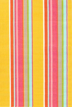 Dash & Albert | Happy Yellow Stripe Indoor/Outdoor Rug | We%27re wagging with joy over this sunny striped number in washable polypropylene.