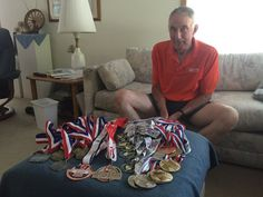 Carroll Marty sits in his home on Thursday July 14, 2016, with only around one-fourth of the medals he has received from competing in the Iowa Games and Senior Games since they began in 1987. Photo by Grayson Schmidt/Ames Tribune http://www.amestrib.com/news/ames-resident-marks-30-years-iowa-games-volunteer
