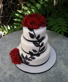 Black, red, and white wedding cake . I LOVE this design, especially since we're using tree decorations.