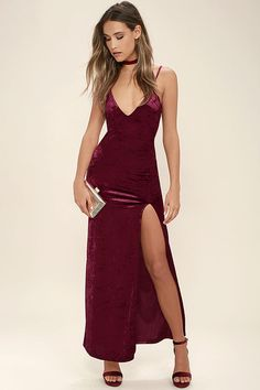 The Nobody But You Burgundy Velvet Maxi Dress is the only thing on our minds lately! Stretch velvet creates a figure flaunting fit from a plunging, V-neckline to a maxi skirt with a thigh high slit. Adjustable skinny straps.