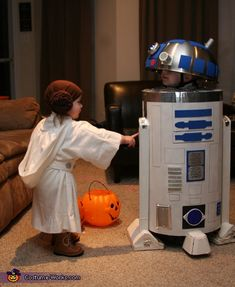 R2D2 and Princess Leia - homemade Halloween costumes  This is so cute!!! COuld totally make the Princess Leia get up and I'm thinking metal mixing bowl on a bike helmet for r2d2 with a chicken wire body. @Jenn L Winston do you remember the pepsi can and machine?