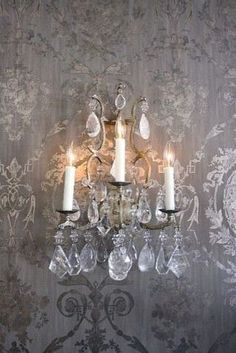 I picked up a couple pairs of crunchy and crystal-y sconces in the South of France last fall. Perfect for a bathroom or two. Huff Harrington