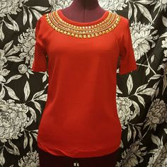 Michael kors red shirt Gorgeous short sleeve stretchy michael kors blouse, red with gold detailing at neckline.  Size small  95% viscose 5% spandex MICHAEL Michael Kors Tops