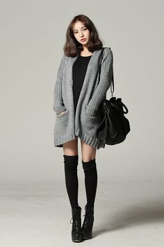 Cute winter to spring outfit with the black dress, huge grey cardigan, black over the knee tights, black shoulder purse, and black heeled boots.