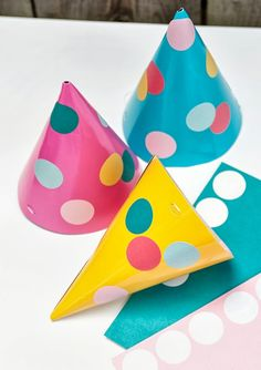 sprinkle party hats using paper source round stickers- great two year old craft activity!