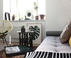 MONSTERA plant print in this beautiful living room.