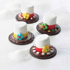 Simple chocolate wafer cookies are transformed into cute snowman hats to help celebrate the season.