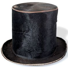 Lincoln wore this hat on the train journey from his home in Springfield, Illinois, to his inauguration in Washintgon, D.C. Or at least, he wore it until he reached New York, when he met an enterprising hatter; that gentleman remarked upon the 'lived-in' nature of Lincoln's chapeau, and offered to trade him the old for a new one.