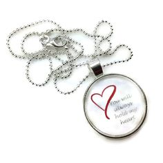 A beautiful glass dome pendant style necklace, with a great inspirational saying 'You will always hold my heart.