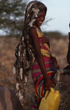Aurora Photos Somali girl filling water can Pray for Somalia, please !! For everyone there. With love.