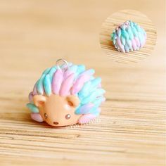 "Hi everyone! Here is a little ""watercolour"" hedgehog charm! He was made with regular white polymer clay and then I painted him with watered down acrylic paints to give his spikes a watercolour effect I think I still have some practise/experimenting to do, but I really love how it came out seeing as it was the first one I made Hope you like it! ✌️ #polymerclay #polymer #clay #cute #kawaii #polymerclaycharms #hedgehog #craft #art #handmade #sculpey #fimo #premo"