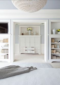 grey walls, light floor, white furniture