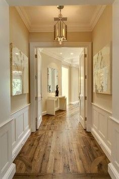 Love the cream walls white wood & medium wood floors! .... ♥♥ ...