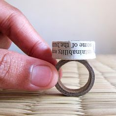 The ring is made of a roller paper bead that I lovingly handcrafted from glossy newspaper sheets. The paper beads are made by rolling thick folded newspaper strips. The ring base is custom made from strong recycled card board.
