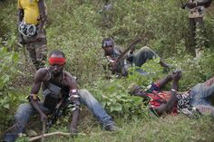 Anti-balaka fighters from the town of Bossembele rest while on patrol in the Boeing district of Bangui, Central African Republic, Feb. 24, 2014. (Camille Lepage/ Reuters)