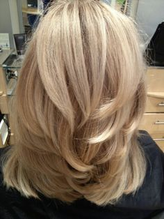I cut it to a medium length, put short to medium layers throughout. Round brushed every layer, starting from the bottom. This is how you get this look!!
