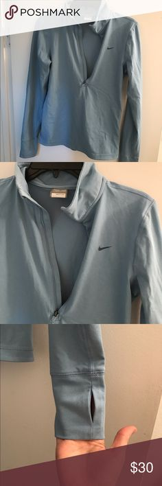 Nike FITDRY pullover, EUC. Light blue Nike FITDRY pullover. Half zip and thumb holes. Mid-weight. 61% cotton, 33% poly, 6% spandex. Size small (4-6). Smoke free home. Nike Tops Tees - Long Sleeve