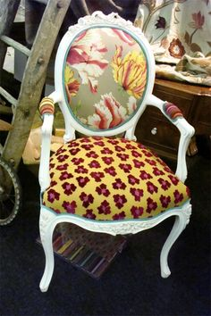 Vintage chair covered with three contemporary prints at The Decorative Textiles & Antiques Fair, London